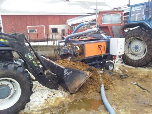 A Milston separator in process of separating manure for reuse.
